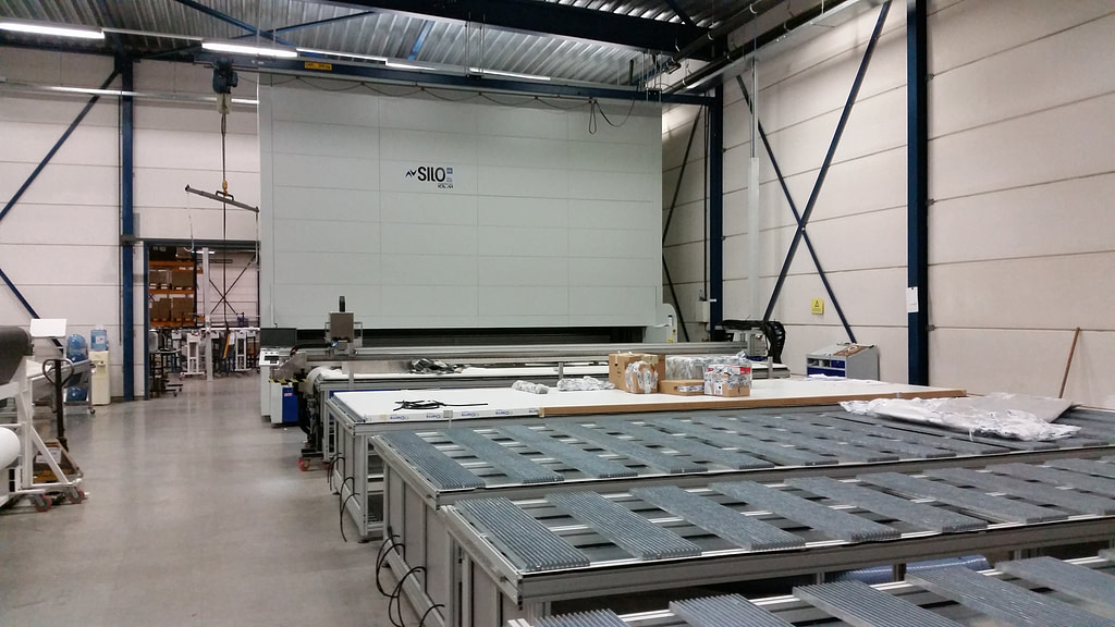 ICAM Online En | Automated and safe storage of the technical fabric rolls for Milestone